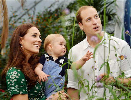 This photo taken Wednesday, July 2, 2014, shows Britain's Prince William and Kate Duchess of Cambridge and the Prince George during a visit to the Sensational Butterflies exhibition at the Natural History Museum, London. (AP Photo/John Stillwell, Pool)