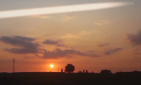 UFO Appears During Sunset Time Lapse Video (Video)