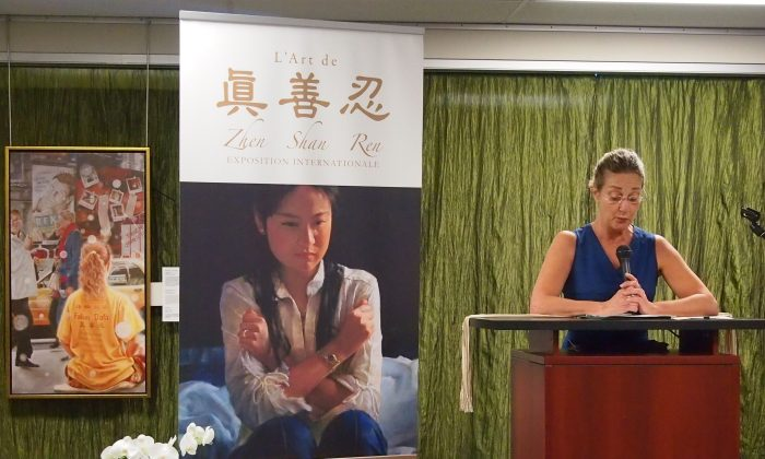 """Diane Du Sablon, special assistant to Irwin Cotler, Member of Parliament for Mount Royal, gave a speech on behalf of the MP at the opening of the Zhen Shan Ren art exhibit in Montreal on Sept. 27, 2014. In an interview later, Du Sablon said: """"Mr Cotler has worked during his whole life for international justice, human rights. He was elected to Parliament in 1999 … with the intention to pursue this mission. … Mr. Kunlun Zhang was the first Falun Gong practitioner that professor Cotler represented as an MP. His relationship with Falun Dafa started at that moment."""" (Nathalie Dieul/Epoch Times)"""