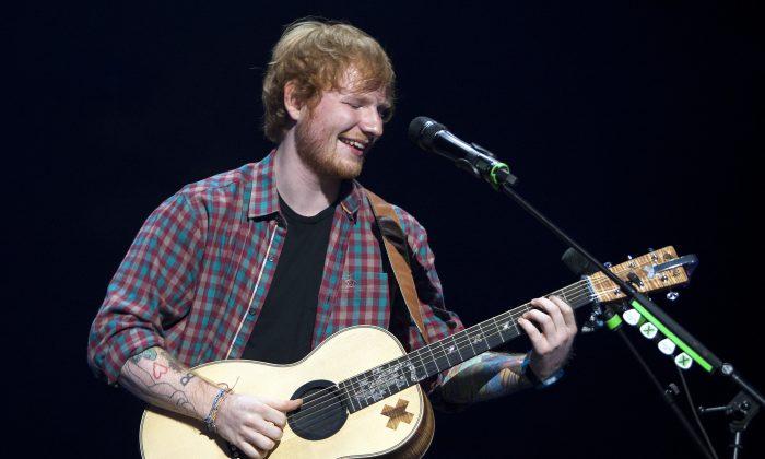 English singer/songwriter Ed Sheeran performed at the Gwinnett Center Arena on Friday, September 12, 2014, in Atlanta, Ga. (Photo by Dan Harr/Invision/AP)