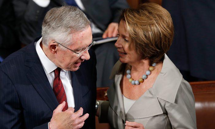Senate Majority Leader Harry Reid (L) (D-Nev.) speaks with House Minority leader Nancy Pelosi (R) (D-Calif.) at the U.S. Capitol in Washington, D.C., on Sept. 18, 2014. (Win McNamee/Getty Images)