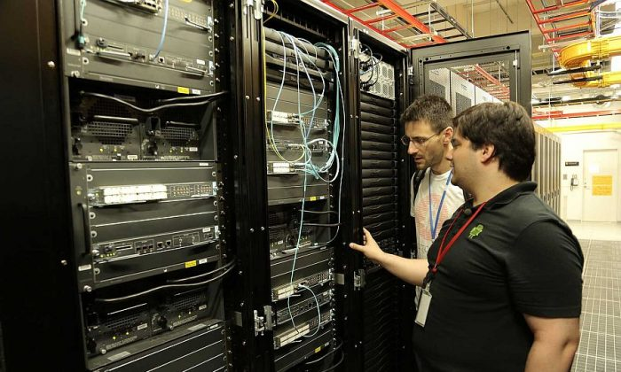 """Mark Karpeles showing director Nicholas Mross the Mt. Gox bitcoin servers in Tokyo, Japan, in a scene from the documentary """"The Rise and Rise of Bitcoin."""" (Fair Acres Media)"""