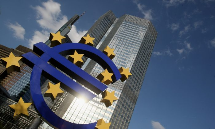 A huge euro logo stands in front of the headquarters of the European Central Bank (ECB) on April 9, 2009 in Frankfurt am Main, Germany. (Ralph Orlowski/Getty Images)