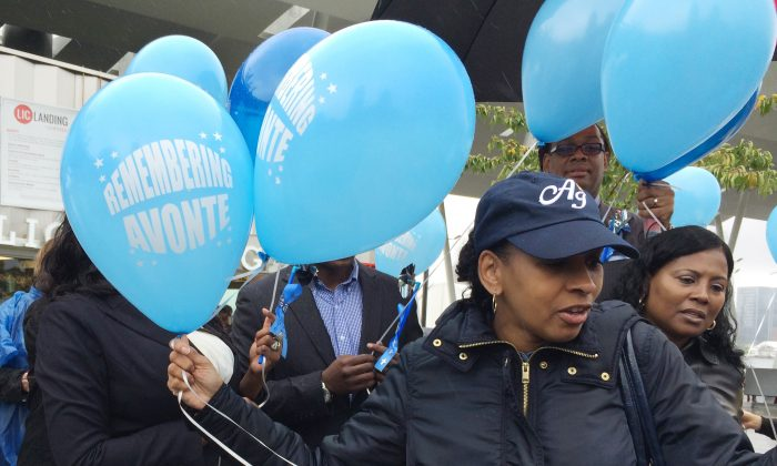 Vanessa Fontaine releases balloons in memory of her late son, Avonte Oquendo, at an event in New York marking the one year anniversary of Avonte's disappearance, Saturday, Oct. 4, 2014. The 14-year-old autistic boy wandered out of his school on Oct. 4, 2013 and was later found dead in an apparent accidental drowning. (AP Photo/Colleen Long)