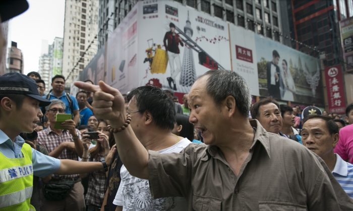 Pro government supporters yell at student demonstrators as tensions continue in the neighborhood of Mongkok, Oct. 4, 2014 in Hong Kong. (Paula Bronstein/Getty Images)