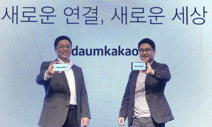 "In this Oct. 1, 2014 photo released by Daum Kakao, Saehoon Choi, left, and Sirgoo Lee, the two co-CEOs of Daum Kakao, an Internet portal and app developer, show their company's new logo during a press conference in Seoul, South Korea. South Korea's president is cracking down on rumors in cyberspace in a campaign that threatens the popularity of Daum Kakao owned Kakao Talk, the leading social media service in a country with ambitions to become a global technology leader. Prosecutors announced the crackdown two weeks ago after President Park Geun-hye complained about insults directed at her and said false rumors ""divided the society."" (AP Photo/Daum Kakao)"