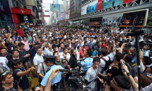 Violence in Hong Kong Has Ties to Beijing