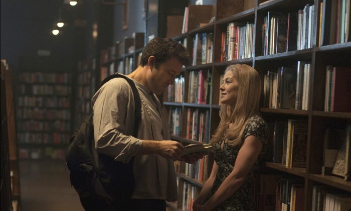 """Ben Affleck and Rosamund Pike appear in a scene from """"Gone Girl."""" (AP Photo/20th Century Fox, Merrick Morton)"""