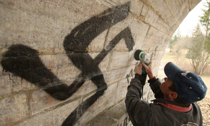 File photo of a municipal worker cleaning Nazi swastikas. (Kirill Kudryavtsev/AFP/Getty Images)