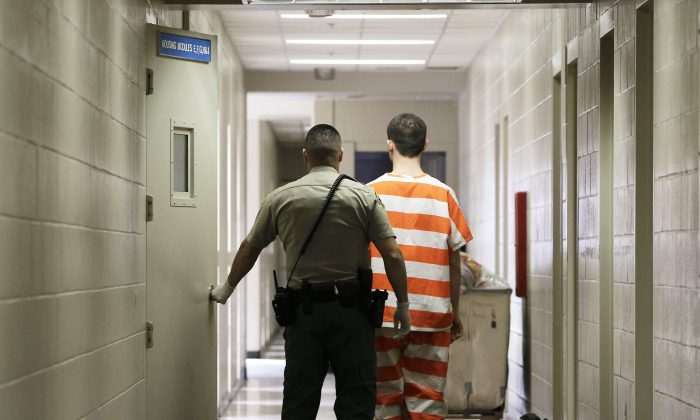 An inmate at the Madera County Jail is taken to an inmate housing unit in Madera, Calif., Feb. 21, 2013. (AP Photo/Rich Pedroncelli, file)