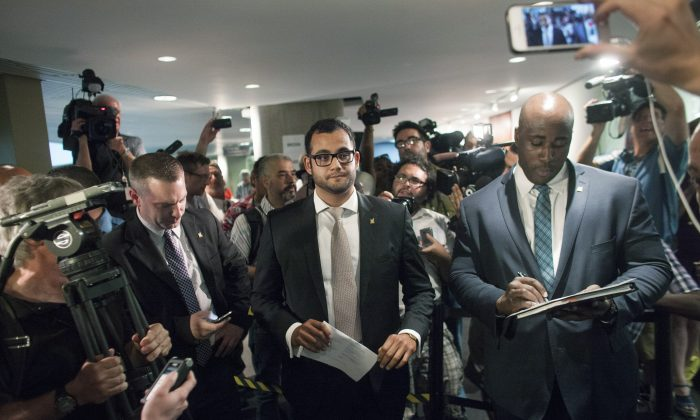 Amin Massoudi (C), Communications & Media Relations for Toronto Mayor Rob Ford, allows selected media into the mayor's press conference in Toronto on June 30, 2014, Ford's first day back to work after taking part in a rehab program. (Brett Gundlock/Getty Images)
