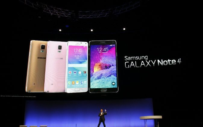 Executive Vice President of electronics giant Samsung D J Lee presents a new version of the company's giant-sized smartphone, the Galaxy Note 4, In Berlin, Germany on Sept. 3, 2014 in advance of the consumer electronics trade fair 'Internationale Funk Ausstellung '(IFA). IFA, one of Europe's biggest showcases of the latest electronic gadgets, is scheduled to open on September 5 and run until Sept. 10, 2014. (Odd Andersen/AFP/Getty Images)