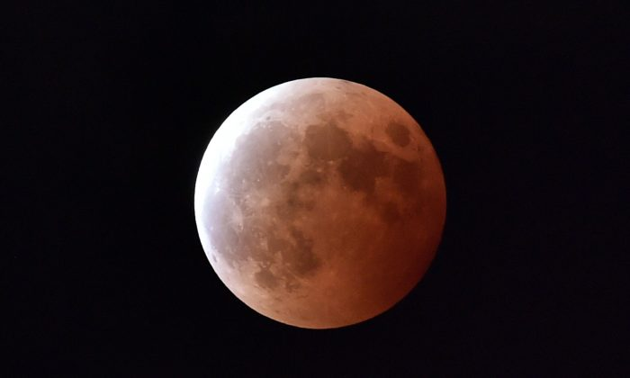 A lunar eclipse is seen in Tokyo on Oct. 8, 2014. (AFP/Getty Images)