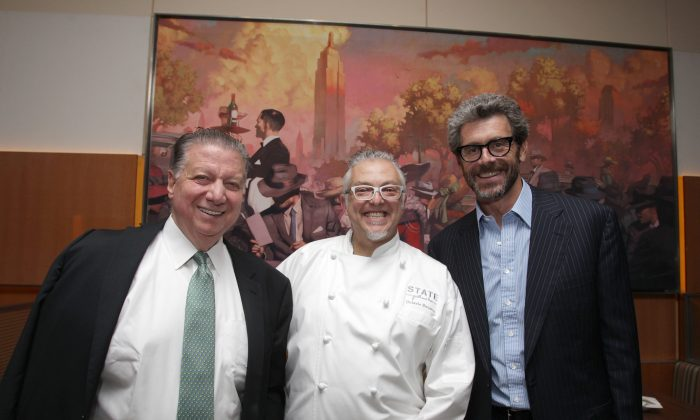 (L–R) CEO of Patina Restaurant Group Nick Valenti, Executive Chef Octavio Becerra, and President, CEO, and Chairman of Empire State Realty Trust Anthony E. Malkin at the press opening of STATE Grill on Oct. 7. (Donald Traill/Invision for Patina Restaurant Group/AP Images)