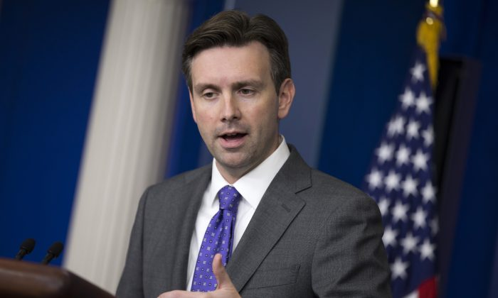 White House press secretary Josh Earnest gestures as he answers a question during the daily press briefing at the White House in Washington, Wednesday, Oct. 8, 2014. Earnest talked about temperature screenings at five airports for passengers arriving from West Africa to fight the Ebola outbreak. (AP Photo/Evan Vucci)