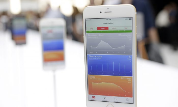 The iPhone 6 Plus is displayed during an announcement of new products by Apple on Tuesday, Sept. 9, 2014, in Cupertino, Calif. (AP Photo/Marcio Jose Sanchez)