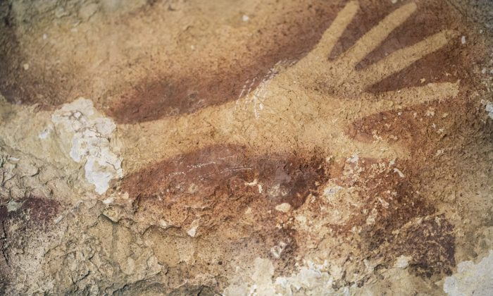 Stencils of hands in a cave in Indonesia. Ancient cave drawings in Indonesia are as old as famous prehistoric art in Europe, according to a new study that shows our ancestors were drawing all over the world 40,000 years ago. And it hints at an even earlier dawn of creativity in modern humans than scientists had thought. (AP Photo/Kinez Riza, Nature Magazine)