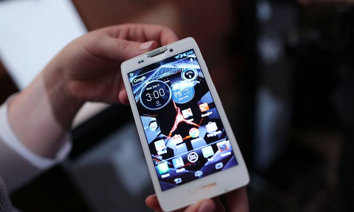 The new Motorola Razr HD smartphone is displayed at the launch of three new smartphones under the Razr brand that will become available for Verizon customers in New York City on Sept. 5, 2012. The new phones, the Droid Razr HD, the Razr M and the Razr Maxx HD, will all use Google's Android operating system. (Spencer Platt/Getty Images)