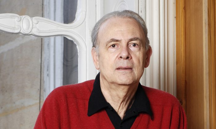 French novelist Patrick Modiano poses for a photograph. Patrick Modiano of France has won the 2014 Nobel Prize for Literature, it was announced Thursday, Oct. 9, 2014. (AP Photo/Catherine Helie, Gallimard)