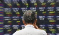 As Dow Average Drops Triple Digits, Investors Brace for Turbulence