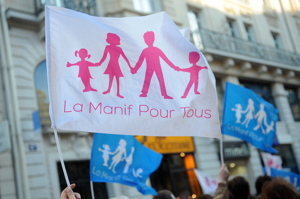 PARIS, FRANCE - APRIL 23:  Anti-same sex marriage activists of the anti-gay marriage movement 'la Manif pour Tous' protest during a demonstration, a few hours after the French Parliament adopted gay marriage law at the Assemblee Nationale on April 23, 2013 in Paris, France. The bill was approved by a vote in Parliament of 331 to 225. (Photo by Antoine Antoniol/ Getty Images)