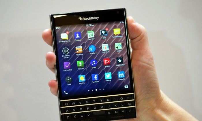 A woman holds the Blackberry Passport smartphone during at a simultaneous launch event in London on Sept. 24, 2014. (Carl Court/AFP/Getty Images)