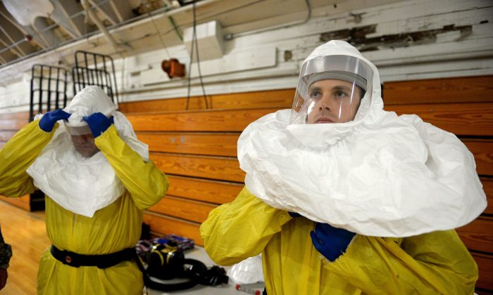 Members of the Army's 101st Airborne Division conduct a training exercise at Ft. Campbell, Ky., Thursday, Oct. 9, 2014. Members will travel to Liberia to build treatment centers and conduct medical training as part of the fight against the Ebola epidemic.  (AP Photo/The Courier-Journal, Stephen Lance Dennee)