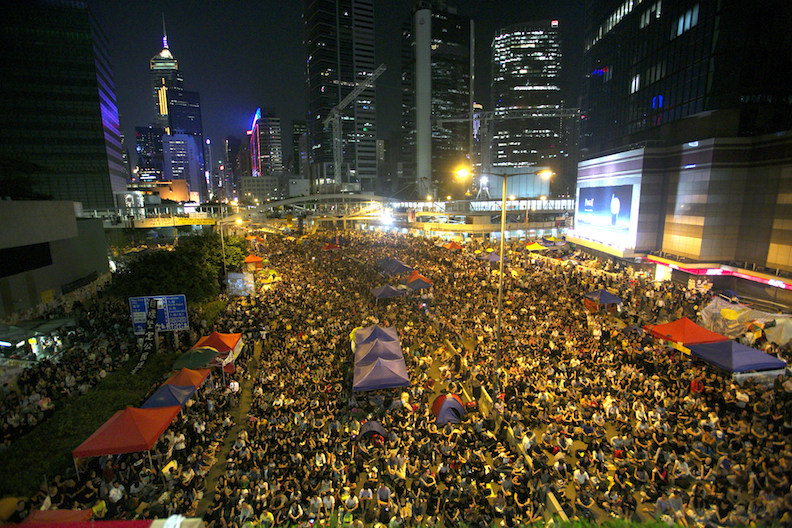 """Thousands of pro-democratic protesters fill what they are now calling """"Umbrella Square,"""" in the Central District of Hong Kong, where all of the Government officers are on Oct. 10, 2014. Thousands came in support of the protest after the Government canceled today's talks with the organizers of the movement. (Benjamin Chasteen/Epoch Times)"""