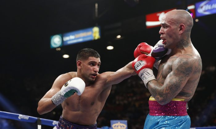 England's Amir Khan, left, connects with a left against Luis Collazo in their silver welterweight title boxing fight Saturday, May 3, 2014, in Las Vegas. (AP Photo/Eric Jamison)
