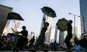 Protesting With Grace in Hong Kong Umbrella Dance