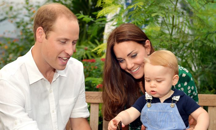 A photograph taken in London on Wednesday July 2, 2014, to mark Britain's Prince George's first birthday, shows Prince William (L) and Catherine, Duchess of Cambridge with Prince George during a visit to the Sensational Butterflies exhibition at the Natural History Museum in London. (AFP/Getty Images)