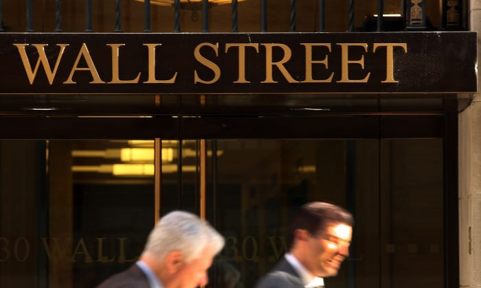 People walk down Wall Street on Oct. 14, 2014, in New York City. (Spencer Platt/Getty Images)