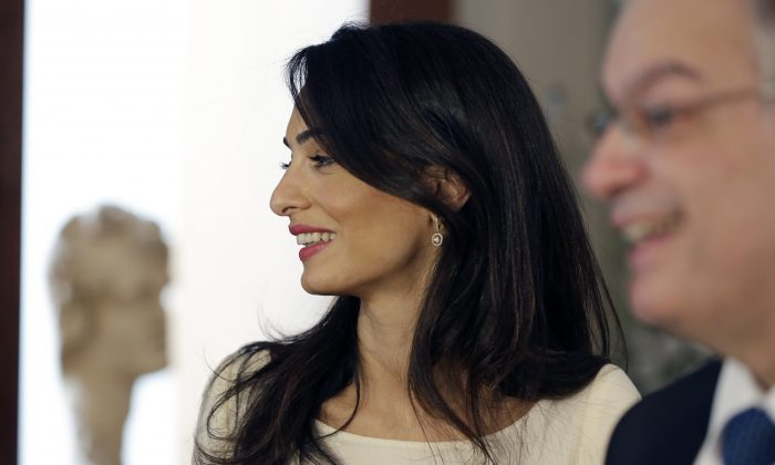Lawyer Amal Clooney, attends a meeting with Greek Culture Minister Kostas Tassoulas, in Athens, Tuesday, Oct. 14, 2014. (AP Photo/Thanassis Stavrakis, Pool)