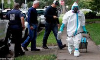 Dallas Health Worker Who Aided 'Patient Zero' Infected With Ebola