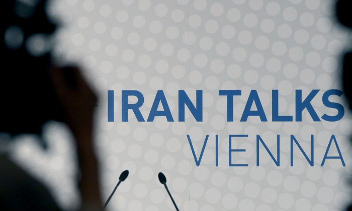 Video cameras stand in front of a poster of the Iran talks during closed-door nuclear talks at a hotel in Vienna, Austria, Tuesday, Oct. 14, 2014. With differences still unresolved and the deadline for a deal nearing, Iran and the US have a choice to make: Extend nuclear talks for a second time or face the risk of renewed confrontation and armed conflict. US Secretary of State John Kerry meets Wednesday in Vienna with Iranian Foreign Minister Mohammad Javad Zarif to try and advance the talks and meet the target date of Nov. 24. (AP Photo/Ronald Zak)