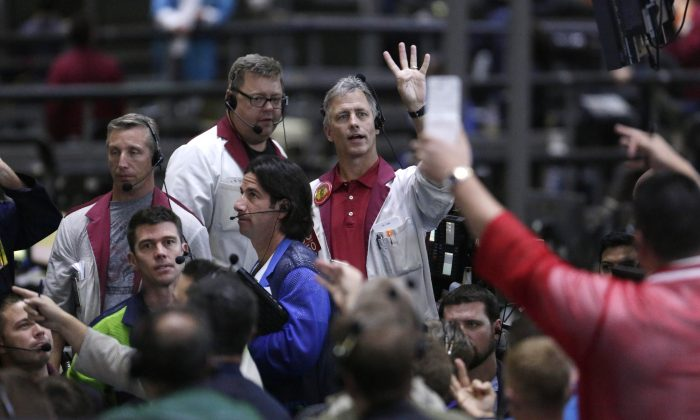 Traders work in the ten-year bond pit on the floor of the CME Group in Chicago on Sept. 24, 2014. Main Street investors have poured a trillion dollars into bonds since the financial crisis, and helped send prices soaring. As fund managers and regulators fret about an inevitable sell-off, the bigger fear is that when people go to unload, there won't be anyone to buy. (AP Photo/M. Spencer Green)