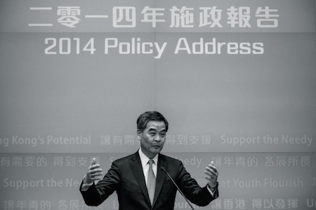 Chief Executive Leung Chun-ying gestures during a press conference after his 2014 policy address in Hong Kong on Jan. 15. Leung has reportedly pocketed millions from a business deal with Australian engineering firm UGL, raising charges of a conflict of interest. (Philippe Lopez/AFP/Getty Images)
