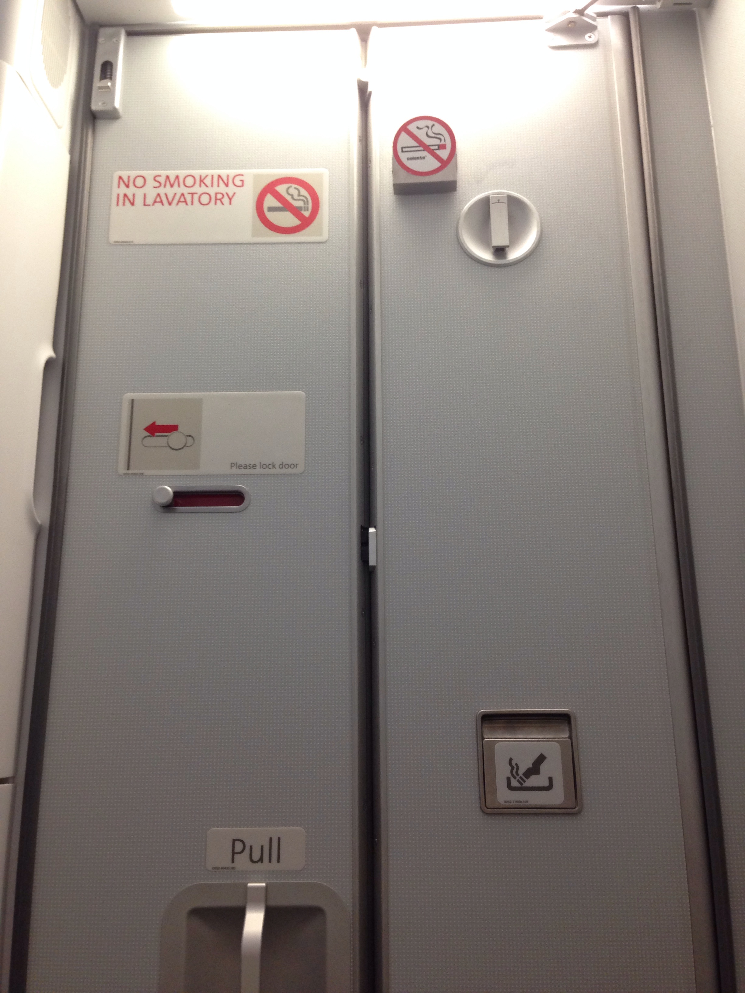 No smoking sign in the lavatory