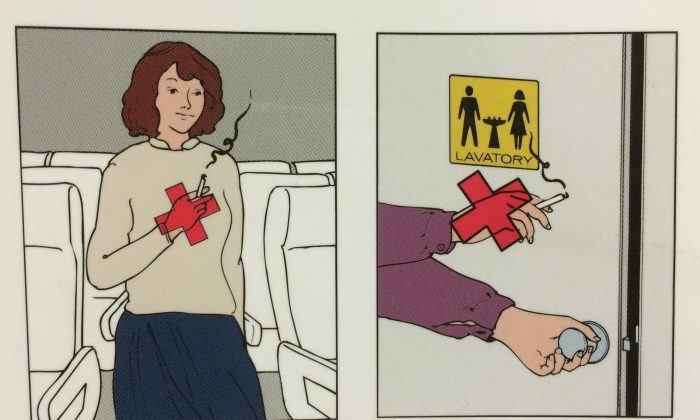 Photo of airplane safety instructions, no smoking sign.