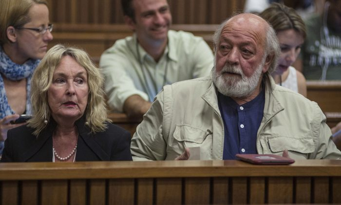June, left, and Barry Steenkamp, parents of the late Reeva Steenkamp, attend court on the third day of mitigation of sentencing for Oscar Pistorius at the high court in Pretoria, South Africa, Wednesday, Oct. 15, 2014. Pistorius faces sentencing this week in the South African court after being convicted of culpable homicide for killing his girlfriend Reeva Steenkamp.  (AP Photo/Ihsaan Haffejee. Pool)