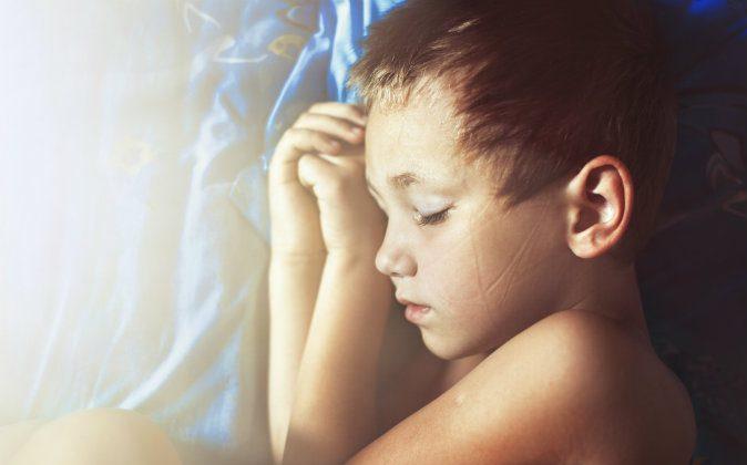 Image of a boy sleeping via Shutterstock