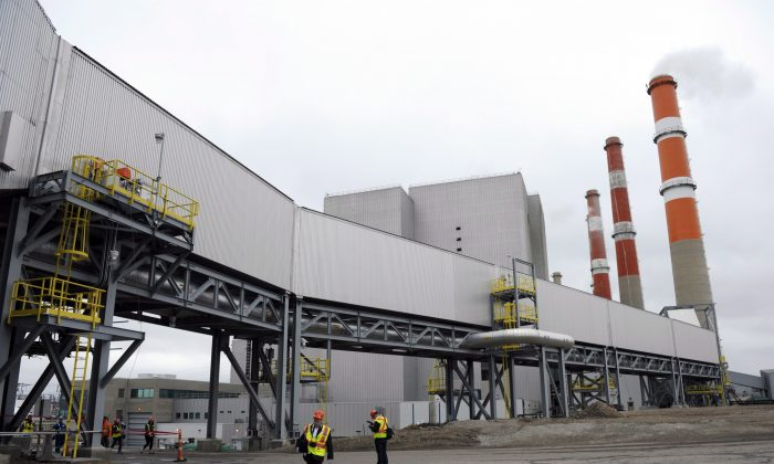 Part of a carbon capture and storage facility is pictured at the Boundary Dam Power Station (background) in Estevan, Sask. on Thursday, October 2, 2014. Saskatchewan's power utility is heralding its carbon capture and storage project, touted as the world's first commercial-scale operation of its kind. But Dale Eisler questions whether it will amount to much. (The Canadian Press/Michael Bell)