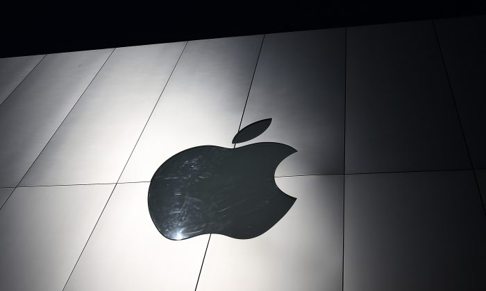 The Apple logo is displayed on the exterior of an Apple Store in San Francisco, Calif., on April 23, 2013. (Justin Sullivan/Getty Images)