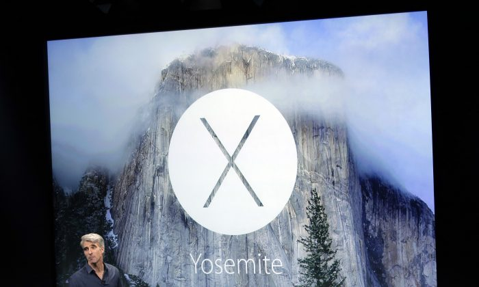 Craig Federighi, senior vice president of Software Engineering at Apple, discusses the operating system update during an event at Apple headquarters on Thursday, Oct. 16, 2014 in Cupertino, Calif. (AP Photo/Marcio Jose Sanchez)