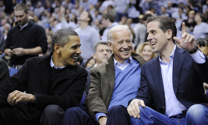 (L-R) Former President Barack Obama, former Vice President Joe Biden, and his son Hunter Biden, at a college basketball game in Washington on Jan. 30, 2010. (AP Photo/Nick Wass)
