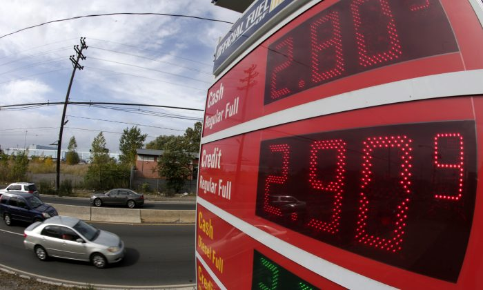 Gas prices below $3 dollars are displayed at a gas stationOct. 15, 2014, in Jersey City, NJ.  (AP Photo/Julio Cortez)