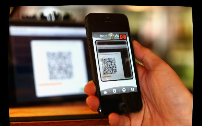 In this photo illustration, a customer scans a QR code to pay for drinks using bit coins in Sydney, Australia on Sept. 19, 2013. (Cameron Spencer/Getty Images; effects added by Epoch Times)