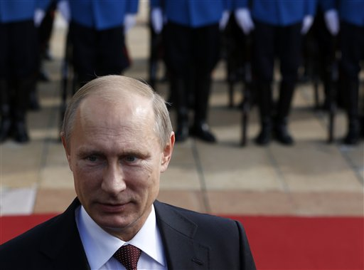 Russian President Vladimir Putin reviews a guard of honor during a welcoming ceremony in Belgrade, Serbia, Thursday, Oct. 16, 2014. Putin arrived on a one-day official visit to Serbia during which he will attend a military parade commemorating the 70th anniversary of Belgrade's liberation from Nazi occupation. (AP Photo/Darko Vojinovic)