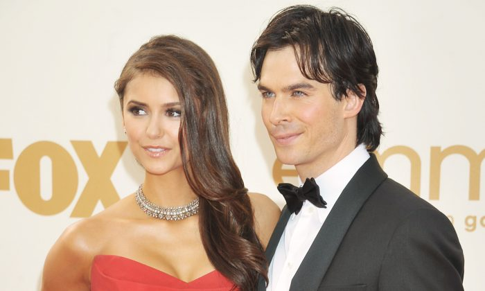 Nina Dobrev and Ian Somerhalder arrive at the Academy of Television Arts & Sciences 63rd Primetime Emmy Awards at Nokia Theatre L.A. Live on September 18, 2011 in Los Angeles, California. (Photo by /Invision for the Academy of Television Arts & Sciences/AP Images)