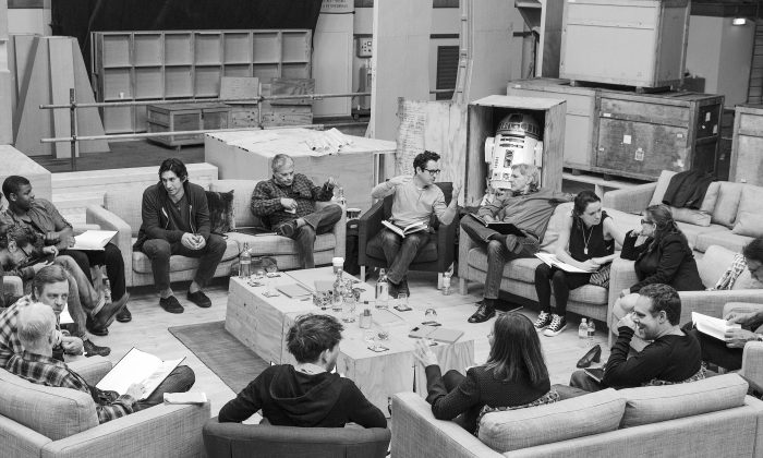This Tuesday, April 29, 2014 photo provided by Lucasfilm shows Star Wars writer/director/producer J.J. Abrams, rear center, at the cast read-through of Star Wars: Episode VII at Pinewood Studios near London. Clockwise from top right are Harrison Ford, Daisy Ridley, Carrie Fisher, Peter Mayhew, producer Bryan Burk, Lucasfilm President and Producer Kathleen Kennedy, Domhnall Gleeson, Anthony Daniels, Mark Hamill, Andy Serkis, Oscar Isaac, John Boyega, Adam Driver and writer Lawrence Kasdan. (AP Photo/Lucasfilm, David James)